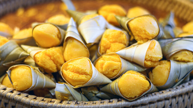 Yellow Toddy Palm Cake, Thai dessert made from steamed toddy palm and packaging from banana leaf