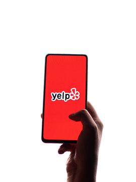 Assam, india - November 15, 2020 : Yelp logo on phone screen stock image.