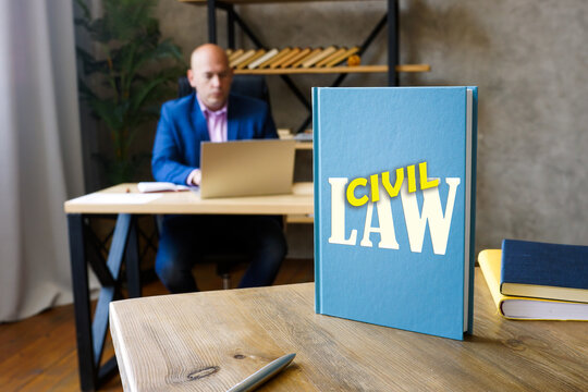 LAW CIVIL book in the hands of a lawyer. The civil law system is intellectualized within the framework ofRoman law, and with core principlescodifiedinto a referable system.