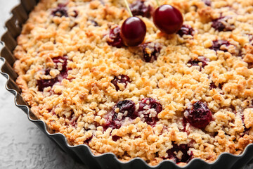 Baking dish with tasty cherry pie on light background, closeup