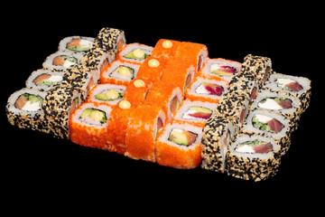 Fototapeta Japanese food: maki and nigiri sushi set on black background. side view composition. obraz