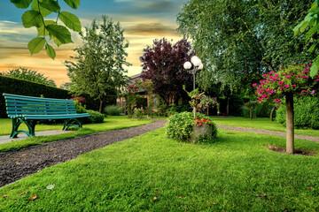 Obraz Dreamlike garden design with grass, paths, flowers and other plants - fototapety do salonu
