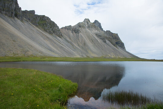 Vestrahorn mountain reflecting in the water, Iceland