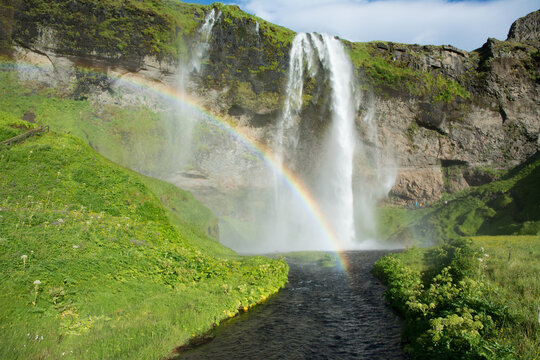 Double waterfall with a rainbow, Seljalandsfoss, Iceland