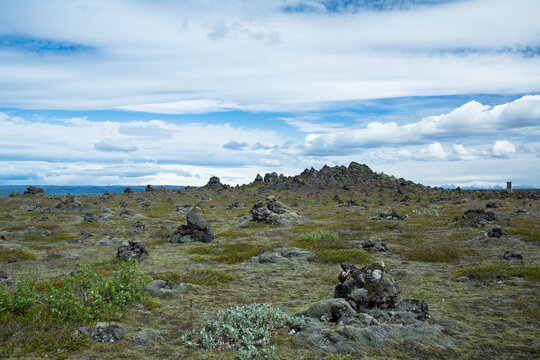 Volcanic landscape and blue cloudy sky in Iceland