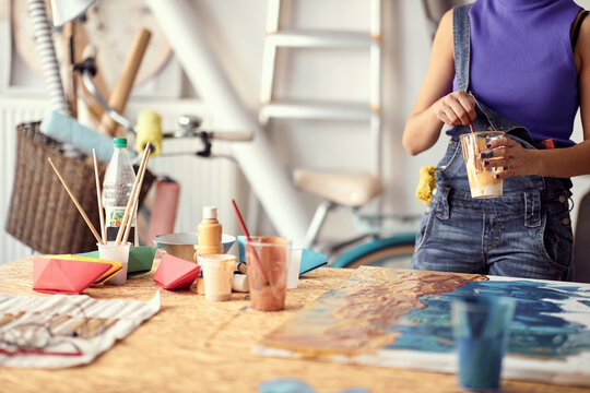Young female painter artist creating a piece