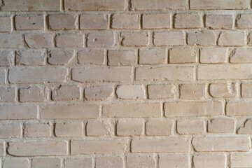 A bright brick wall in an old tenement house. August 2021.