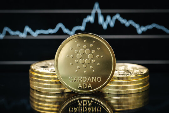 Cardano Ada cryptocurrency coin close-up, in front of a price chart