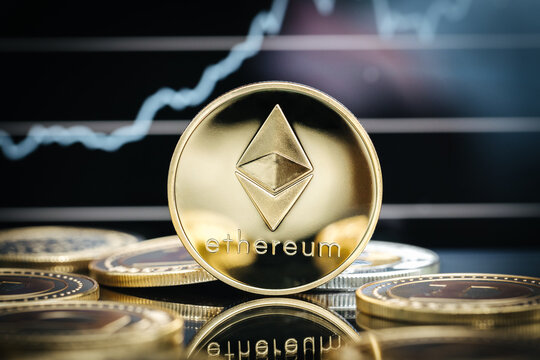Ethereum cryptocurrency, physical coin close-up in front of a price chart