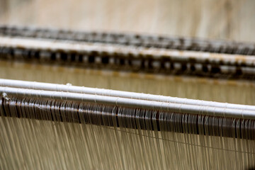 Weaving machine cotton fabric on natural background.