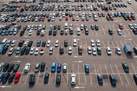 Big parking near shopping center or mall, top aerial view from high.