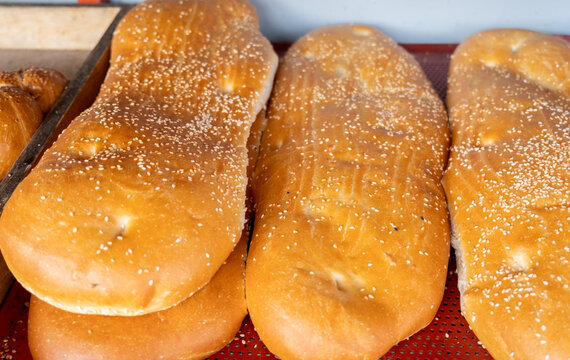 Fresh caucasian bread with sesame seeds sale at the city farmers market