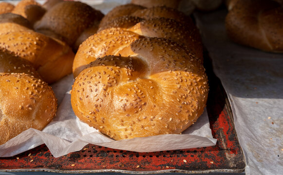 Fresh Challah with sesame seeds sold at the city farmers market