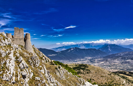 Ruined and abandoned dreamlike medieval castle on a mountain peak in Rocca Calascio, L'Aquila, Italy