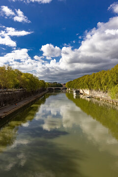 Tiber river in Rome from Sisto bridge with floating house and Mazzini bridge on background