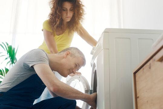 Repairman checking a broken washer
