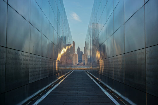 Jersey City, NJ - December 14, 2015: The Manhattan skyline seen through Empty Sky, the official memorial to the state's victims of the 9-11 terror attack, located in Liberty State Park.