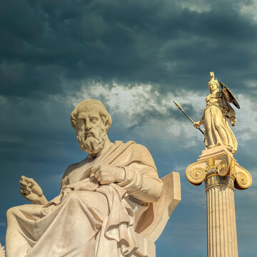 Plato the ancient Greek philosopher and Athena goddess marble statues under dramatic cloudy sky