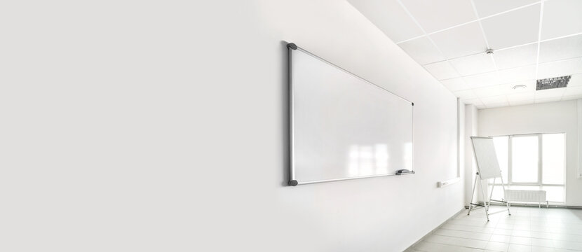Empty training seminar room with large white chalkboard