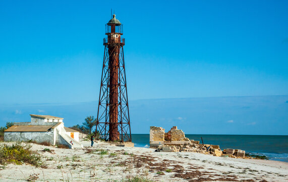 An old rusty lighthouse on the seashore