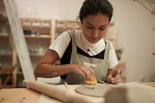 Woman creating DIY clay decoration