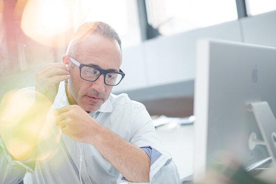 Older man working on computer at desk