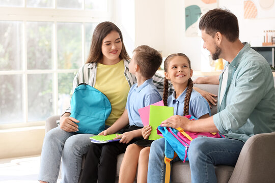 Parents getting their little children ready for school