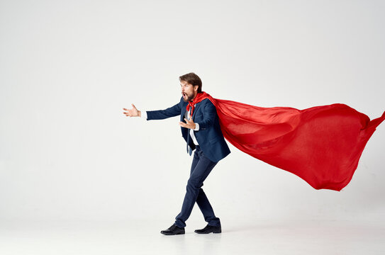 man wearing red cape superman jump