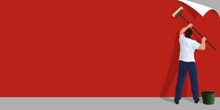Fond uni pour une présentation commerciale avec un homme qui colle une affiche publicitaire rouge sur un mur de béton.