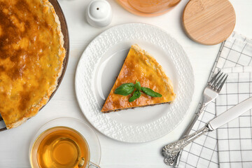 Delicious pie with minced meat on white wooden table, flat lay