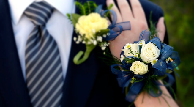 Date Prom Flowers Formal Wear Corsage Hand on Shoulder selective focus blur