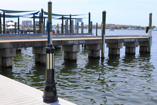 A light post on a fishing dock  by the ocean