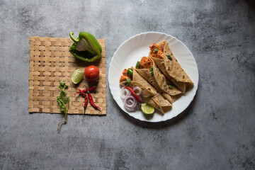 Ready to eat Burrito or tortilla meat wraps served. Top view. It is also known as chicken wraps in the Indian subcontinent.