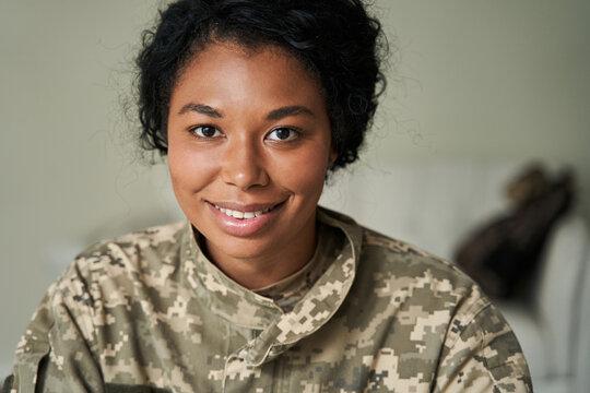 Black female soldier wearing camouflage uniform