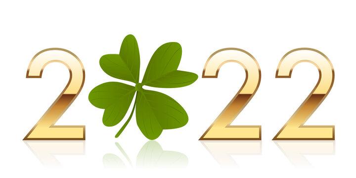 Carte de vœux porte bonheur, avec 2022 écrit en chiffres dorés autour d'un trèfle à quatre feuilles qui symbolise la chance et la réussite.