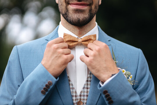 Groom wearing a bow tie on his wedding day close-up
