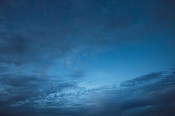 blue evening sky with dark clouds.
