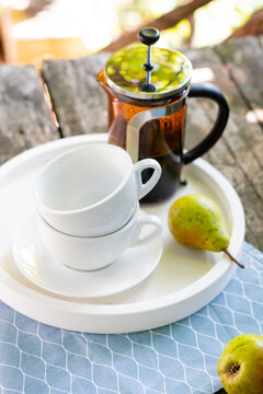 Breakfast serving for two, tea cups and fruits