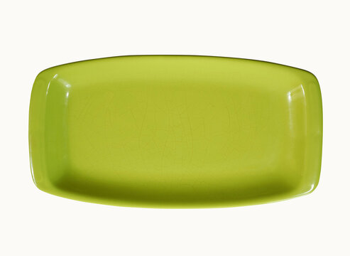 Old rectangular green dish with small cracks isolated on white