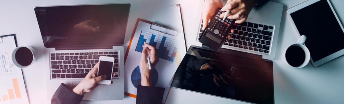 Business women working together at office desk, hands close up with calculator out financial data. teamwork workplace strategy Concept.