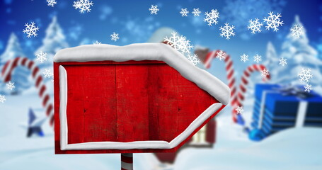 Digital image of snowflakes falling over red wooden sign post against christmas gift box