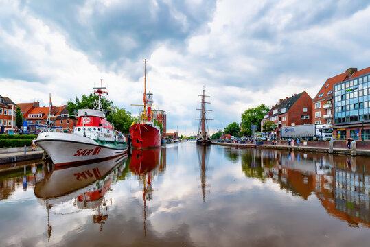 Harbor of Emden city historic light vessel and sailship, Lower Saxony, Germany
