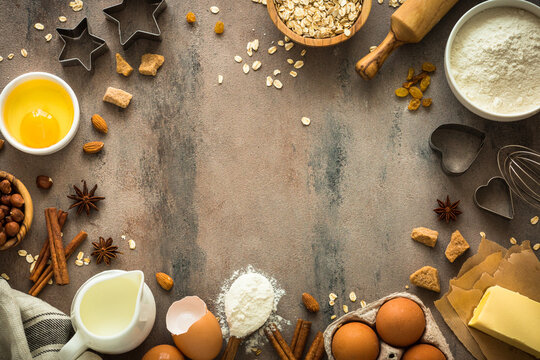 Ingredients for cooking baking. Food frame. Flour, sugar, butter, egg, milk and spices. Top view with copy space.