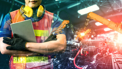 Mechanized industry robot arm and factory worker double exposure . Concept of robotics technology for industrial revolution and automated manufacturing process .