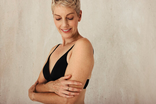Senior woman embracing her aging body