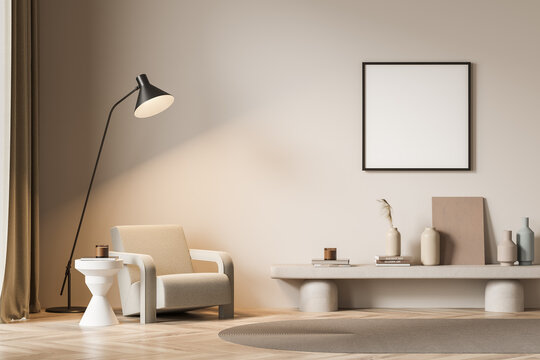 View of armchair in beige living room with square poster