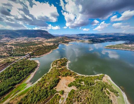 Cloudy sky over Temo lake in Sardinia