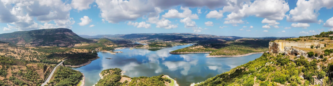 Panoramic view of Temo lake under a cloudy sky