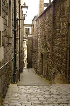 old historic narrow close and lamps in Edinburgh