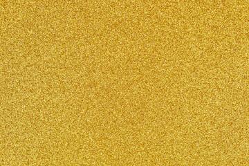Golden shiny glitter texture for festive background